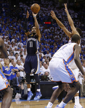 Photo - Memphis' Mike Conley (11) shoots the ball during Game 2 in the second round of the NBA playoffs between the Oklahoma City Thunder and the Memphis Grizzlies at Chesapeake Energy Arena in Oklahoma City, Tuesday, May 7, 2013. Oklahoma  City lost 99-93. Photo by Bryan Terry, The Oklahoman