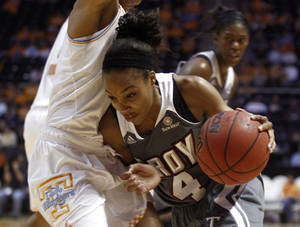 Photo - Troy guard Ashley Beverly-Kelley (4) drives against Tennessee forward Cierra Burdick (11) in the first half of an NCAA college basketball game on Saturday, Dec. 14, 2013, in Knoxville, Tenn. (AP Photo/Wade Payne)