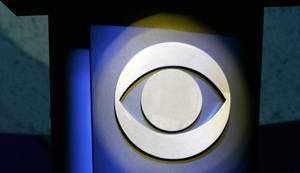 Photo - FILE - In this Jan. 9, 2007 file photo, a CBS Corp. logo is silhouetted in Las Vegas.  CBS reports its quarterly earnings on Wednesday, Feb. 14, 2014. (AP Photo/Jae C. Hong, File)