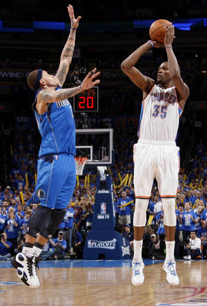 photo - Oklahoma City's Kevin Durant (35) shoots against Dallas' Delonte West (13) during game one of the first round in the NBA playoffs between the Oklahoma City Thunder and the Dallas Mavericks at Chesapeake Energy Arena in Oklahoma City, Saturday, April 28, 2012. Oklahoma City won, 99-98. Photo by Nate Billings, The Oklahoman
