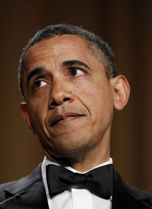 Photo -   President Barack Obama attends the White House Correspondents' Association Dinner, Saturday, April 28, 2012 in Washington. (AP Photo/Haraz N. Ghanbari)