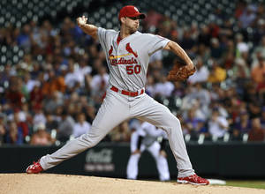 Photo - St. Louis Cardinals starting pitcher Adam Wainwright throws to a Colorado Rockies batter in the first inning of a baseball game in Denver on Wednesday, Sept. 18, 2013. (AP Photo/David Zalubowski)