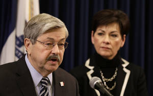 photo - Iowa Gov. Terry Branstad speaks during a news conference as Lt. Gov. Kim Reynolds looks on during the opening day of the Iowa Legislature, Monday, Jan. 14, 2013, at the Statehouse in Des Moines, Iowa. (AP Photo/Charlie Neibergall)
