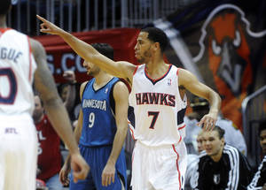 Photo - Atlanta Hawks guard Jannero Pargo reacts after scoring against the Minnesota Timberwolves during the final minutes of an NBA basketball game in Atlanta, Monday, Jan. 21, 2013. Atlanta won 104-96. (AP Photo/John Amis)