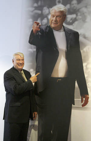 photo -   Former Golden State Warriors head coach Don Nelson smiles posing for a photograph in front of his picture displayed at the Warriors NBA training facility in Oakland, Calif., Tuesday, Aug. 28, 2012. Nelson always did things his way, and it hardly mattered who objected to his coaching techniques. He is the NBA's winningest coach ever because of it, and, now, a Hall of Famer. And, don't forget, he's the one who could regularly be seen smoking a cigar in the parking lot before games. (AP Photo/Jeff Chiu)