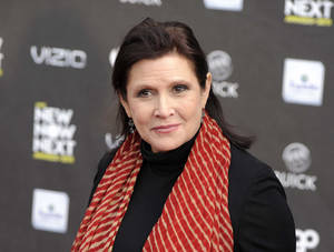 """Photo - FILE - This April 7, 2011 file photo shows Carrie Fisher at the 2011 NewNowNext Awards in Los Angeles. Fisher is excited about her """"Star Wars"""" return, even if she can't say much about it. Production begins in May 2014 on Disney's """"Star Wars"""" film by director J.J. Abrams.  (AP Photo/Chris Pizzello, file)"""