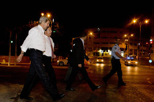 Photo - U.S. Secretary of State John Kerry, left, with Frank Lowenstein, senior advisor to the secretary on Middle East issues, return their hotel just after 4 a.m. on Sunday, June 30, 2013 after finishing a meeting with Prime Minister Netanyahu that took over six hours. After the marathon meeting, Kerry decided to get some air by walking to a park near the hotel where he is staying and the meeting was held. Kerry is shuttling between Palestinian and Israeli leaders in hopes of restarting peace talks. (AP Photo/Jacquelyn Martin, Pool)