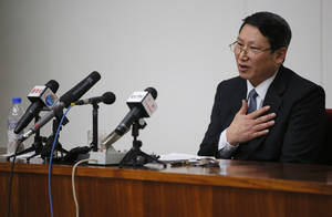 Photo - Kim Jung Wook, a South Korean Baptist missionary, speaks during a news conference in Pyongyang, North Korea, Thursday, Feb. 27, 2014. Kim who was arrested more than four months ago for allegedly trying to establish underground Christian churches in North Korea told reporters Thursday he is sorry for his ``anti-state'' crimes and appealed to North Korean authorities to show him mercy by releasing him from their custody. (AP Photo/Vincent Yu)