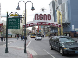 Photo - Pedestrians and traffic on Virginia Street on Thursday, March 27, 2014, in downtown Reno, Nev., where local tourism officials say visitors spent more money and stayed longer last year than they did two years ago. The Reno-Sparks Convention and Visitors Authority said a new survey shows gamblers still drive the Reno-Tahoe market but outdoor recreation and sightseeing in the Sierra are bringing more families and others to the region. (AP Photo/Scott Sonner)