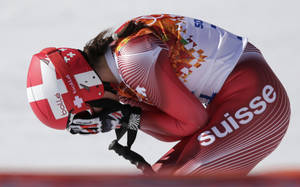 Photo - Switzerland's Dominique Gisin reacts after a women's downhill training run for the Sochi 2014 Winter Olympics, Friday, Feb. 7, 2014, in Krasnaya Polyana, Russia. (AP Photo/Gero Breloer)