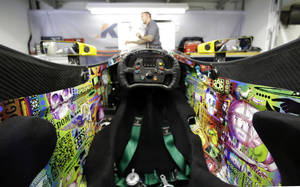 Photo - The cockpit of the car that will be driven by Townsend Bell for the Indianapolis 500 IndyCar auto race in shown in the team garage at the Indianapolis Motor Speedway in Indianapolis, Friday, May 9, 2014. (AP Photo/Michael Conroy)