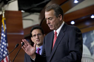 photo - FILE - In this Friday, Dec. 21, 2012, file photo, speaker of the House John Boehner, R-Ohio, joined by House Majority Leader Eric Cantor, R-Va., left, speaks to reporters about the fiscal cliff negotiations at the Capitol in Washington. Lawmakers probably could enact a compromise quickly and easily if Republican leaders let Democrats provide most of the votes.  By trying to pass his plan with GOP votes alone, Boehner could afford to lose only two dozen of the 241 House Republicans. His private head-count found nearly twice that many defectors, party insiders say, forcing Boehner to give up without seeking a formal vote. (AP Photo/J. Scott Applewhite, File)