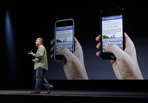 Photo -   Phil Schiller, Apple's senior vice president of worldwide marketing, speaks on stage during an introduction of the new iPhone 5 at an Apple event in San Francisco, Wednesday Sept. 12, 2012. (AP Photo/Eric Risberg)