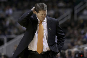 Photo - Oklahoma State coach Travis Ford walks on the sideline during the second half of a second-round game in the NCAA men's college basketball tournament against Oregon in San Jose, Calif., Thursday, March 21, 2013. Oregon won 68-55. (AP Photo/Ben Margot) ORG XMIT: SJA129