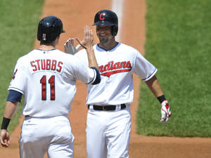 Photo - Cleveland Indians right fielder Ryan Raburn, right, celebrates his two-run home run with center fielder Drew Stubbs against the Chicago White Sox in the third inning of a baseball game, Thursday, August 1, 2013, in Cleveland. (AP Photo/David Richard)