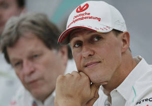"Photo - FILE - This is a Thursday, Oct. 4, 2012 file photo of  Mercedes driver Michael Schumacher, right, of Germany sits with teammate Norbert Haug,  during a news conference to announce his retirement from Formula One at the end of the 2012  in Suzuka, Japan.  Michael Schumacher's manager said Friday April 4, 2014 that the retired Formula One star now ""shows moments of consciousness and awakening,"" more than three months after suffering serious head injuries in a skiing accident. Manager Sabine Kehm said in a statement that ""Michael is making progress on his way."" She added that ""we keep remaining confident."" (AP Photo/Shizuo Kambayashi, File)"
