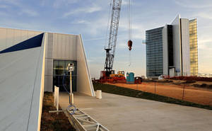 photo - Construction projects and improvements have begun in Oklahoma City's Boathouse District. A fresh trench marks the planned extension of the Bricktown  Canal nearly all the way to the Oklahoma River, holes in the ground indicate the location of new riverside light posts and a crane has begun putting up a massive new ropes course.