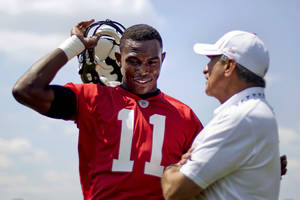 Photo -   Atlanta Falcons wide receiver Julio Jones, left, talks with team owner Arthur Blank during NFL football minicamp, Tuesday, June 19, 2012, in Flowery Branch, Ga. (AP Photo/David Goldman)