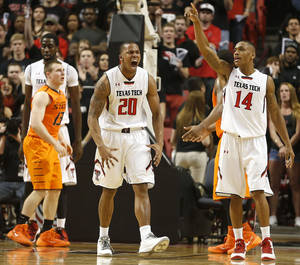 Photo - Texas Tech's Toddrick Gotcher(20) and Robert Turner(14) celebrate after scoring against Oklahoma State during their NCAA college basketball game in Lubbock, Texas, Saturday, Feb, 8, 2014.  (AP Photo/Lubbock Avalanche-Journal, Tori Eichberger) ALL LOCAL TV OUT