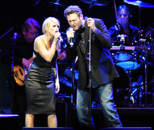 Photo - Miranda Lambert and Blake Shelton perform at the tribute concert for the late George Jones, Friday, Nov. 22, 2013, in Nashville, Tenn. Jones had originally scheduled his final show for Friday. He died April 26. (AP Photo/Mike Strasinger)