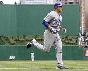 Photo -   Chicago Cubs' Anthony Recker trots around the bases after hitting the Cubs' second home run of the fourth inning of a baseball game against the Pittsburgh Pirates on Sunday, Sept. 9, 2012, in Pittsburgh. (AP Photo/Keith Srakocic)