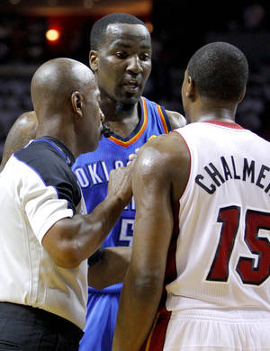 Photo - Oklahoma City's Kendrick Perkins (5) argues with Miami's Mario Chalmers (15) during Game 5 of the NBA Finals between the Oklahoma City Thunder and the Miami Heat at American Airlines Arena, Thursday, June 21, 2012. Photo by Bryan Terry, The Oklahoman