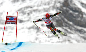 Photo - Bode Miller, of the United States, is airborne during an alpine ski, men's World Cup downhill, in Wengen, Switzerland, Saturday, Jan. 18, 2014. (AP Photo/Alessandro Trovati)