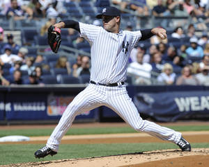 Photo - New York Yankees pitcher David Huff delivers the ball to the Boston Red Sox during the second inning of a baseball game Saturday, Sept. 7, 2013, at Yankee Stadium in New York. (AP Photo/Bill Kostroun)
