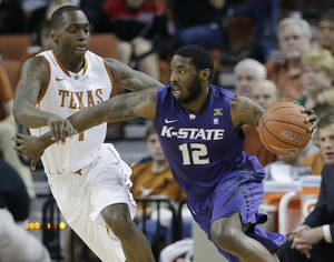 photo - Kansas State&#039;s Omari Lawrence (12) moves the ball past Texas defender Sheldon McClellan, left, during the first half on an NCAA college basketball game, Saturday, Feb. 23, 2013, in Austin, Texas. (AP Photo/Eric Gay)