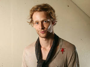 "Photo -   FILE - This Sept. 14, 2011 file photo shows actor Johnny Lewis posing for a portrait during the 36th Toronto International Film Festival in Toronto, Canada. Authorities say Lewis fell to his death after killing an elderly Los Angeles woman. Lewis appeared in the FX television show ""Sons of Anarchy,"" for two seasons. The woman killed is identified as 81-year-old Catherine Davis. (AP Photo/Carlo Allegri, file)"
