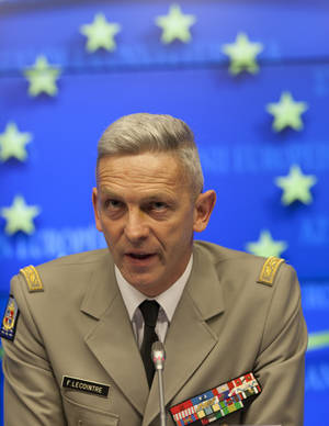 Photo - French Brig. Gen. Francois Lecointre, Mali's mission commander, speaks during a media conference at EU headquarters in Brussels on Tuesday, March 5, 2013. Officials say the commitment of EU member countries to a military training mission in Mali remains strong despite fierce fighting in the country's north, where three French soldiers have been killed.  (AP Photo/Virginia Mayo)
