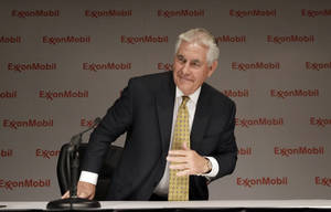 Photo - ExxonMobil CEO Rex Tillerson concludes an availability with reporters after the annual meeting ExxonMobil shareholders meeting in Dallas, Wednesday, May 28, 2014. (AP Photo/LM Otero)