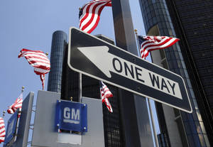 Photo -  The General Motors headquarters is shown in Detroit. General Motors is recalling nearly 60,000 Saturn Aura midsize cars because the automatic transmission shift levers can show the wrong gear. AP Photo  <strong>Carlos Osorio -  AP </strong>