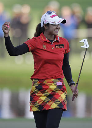 Photo - Pornanong Phatlum of Thailand celebrates after she wins the final round of the Dubai Ladies Masters golf tournament in Dubai, United Arab Emirates, Saturday, Dec. 7, 2013. (AP Photo/Kamran Jebreili)