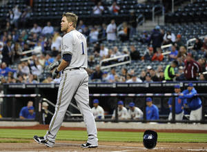 Photo -   Milwaukee Brewers' Corey Hart (1) drops his helmet after striking out against the New York Mets' Miguel Batista and leaving two runners on base in the first inning of a baseball game on Monday, May 14, 2012, at Citi Field in New York. (AP Photo/Kathy Kmonicek)