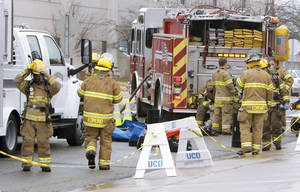 photo - Edmond firefighters work with other local emergency workers during the training exercise at UCO.