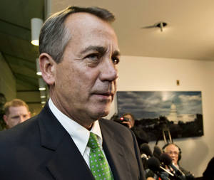 photo - FILE - This Jan. 1, 2013 file photo shows House Speaker John Boehner of Ohio walkig past reporters after a closed-door meeting meeting of House Republicans on Capitol Hill in Washington. The GOP-controlled House will vote next week to permit the government to borrow more money to meet its obligations, a move aimed at heading off a market-rattling confrontation with President Barack Obama over the so-called debt limit. Full details aren't settled yet, but the measure would give the government about three more months of borrowing authority beyond a deadline expected to hit as early as mid-February, a Republican official said Friday.   (AP Photo/J. Scott Applewhite, File)
