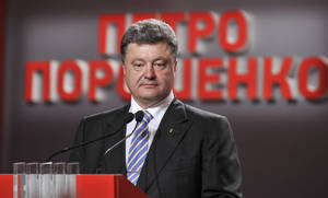 "Photo - Ukrainian presidential candidate Petro Poroshenko during his press conference in Kiev, Ukraine, Sunday, May 25, 2014. An exit poll showed that billionaire candy-maker Petro Poroshenko won Ukraine's presidential election outright Sunday in the first round — a vote that authorities hoped would unify the fractured nation. The text reads""Petro Poroshenko"". (AP Photo/Mykola Lazarenko, Pool)"