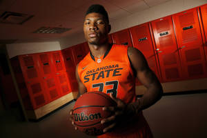 photo - COLLEGE BASKETBALL: OSU's Marcus Smart (33) poses for a photo during basketball media day for Oklahoma State University at Gallagher-Iba Arena in Stillwater, Okla., Monday, Oct. 22, 2012. Photo by Nate Billings, The Oklahoman