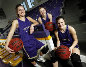Photo - From left, Okarche High School girls basketball players Rae Grellner, 16, Madi Grellner, 17, Kenadey Grellner, 15, pose for a photo in the school's gym in Okarche, Okla., Wednesday, Feb. 27, 2013. The three players are cousins and part of a huge Okarche basketball family.  Photo by Nate Billings, The Oklahoman