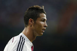 Photo - Real Madrid's Cristiano Ronaldo reacts during a Spanish Super Cup soccer match against Atletico Madrid at Santiago Bernabeu stadium in Madrid, Spain, Tuesday, Aug. 19, 2014 . (AP Photo/Daniel Ochoa de Olza)