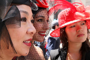 Photo -   Marjorie Lee Woo, left, Sabrina Mashburn, center, and Ashley Woo, Marjorie's daughter, pose for photographers as they take part in the Easter Parade along New York's Fifth Avenue Sunday April 24, 2011. Marjorie Lee Woo made the hats. (AP Photo/Tina Fineberg)