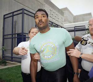 photo -   FILE - This July 16, 1992 file photo shows Rodney King being escorted from jail in Santa Ana, Calif. after he was arrested for investigation of drunken driving. King, whose videotaped beating by police in 1991 led to LA race riots, has died at 47. (AP Photo/Kevork Djansezian, file)