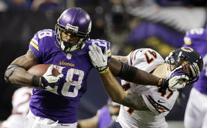 Photo - Minnesota Vikings running back Adrian Peterson, left, tries to break a tackle from Chicago Bears free safety Chris Conte during the fourth quarter of an NFL football game on Sunday, Dec. 1, 2013, in Minneapolis. The Vikings won 23-20 in overtime. (AP Photo/Ann Heisenfelt)