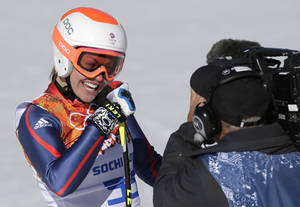 Photo - Britain's Chemmy Alcott smiles after finishing the women's downhill at the Sochi 2014 Winter Olympics, Wednesday, Feb. 12, 2014, in Krasnaya Polyana, Russia. (AP Photo/Gero Breloer)