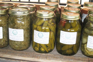 photo - Canned pickles and peppers are among the items being sold at the new MidTown Market at Saints.PHOTO PROVIDED