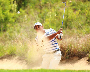 Photo - Georgia State's Davin White hits out of a green side bunker on hole 8 during the second round of the NCAA national championship Sunday, May 25, 2014 at Prairie Dunes Country Club in Hutchinson, Kan. (AP Photo/The Hutchinson News, Travis Morisse)