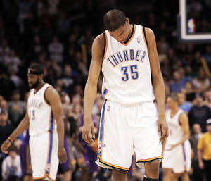 Photo - Thunder forward Kevin Durant reacts late in Oklahoma City's 104-102 loss to the Phoenix Suns on Tuesday at the Ford Center. PHOTO BY NATE BILLINGS, THE OKLAHOMAN