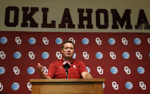 Photo - Oklahoma head coach Bob Stoops answers a question during Media Day in Norman, Okla., Saturday, Aug. 2, 2014. (AP Photo/Sue Ogrocki)