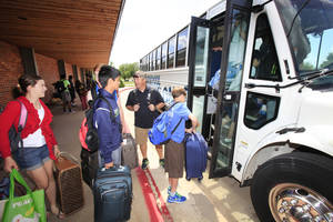 Photo -  Casady School students board a bus to the airport to participate in the National Science Olympiad Tournament. Photo by David McDaniel, The Oklahoman  <strong>David McDaniel -   </strong>